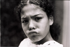 Jazzlyn (Nick Petropoulos) Tags: contaxrtsii trix400 xtol 50mm14planar plustek7600 analog blackandwhite kodak selfdeveloped portrait closefocus 35mmfilm silver halide silverhalide chemicalphotography realphotography houstontexas 2019 kid child closeup pose funny