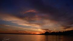 """Douce menace ... ( P-A) Tags: coucherdusoleil silhouette couleurs nuages volumes nuances orange eau lac formes photos simpa© """"nikonflickraward"""" flickrenespañol"""