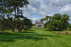 Kingston Lacy - The House from the Cedar Avenue. (margaretgeatches) Tags: grass green blue sky grey clouds cedaravenue trees gardens park house statelyhome nationaltrustproperty kingstonlacy wimborneminster dorset
