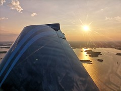 Flight over Helsinki (Toni Kaarttinen) Tags: flight flying helsinki aviation eurostar airplane finlàndia finnland finnlando finlandia finlande finnország フィンランド finlândia finlanda финляндия suomi helsingfors sunset archipelago aerial aerialphotography