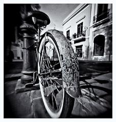 Matchbox Pinhole (Estenopeica de Caja De Fosforos) (Black and White Fine Art) Tags: matchboxcamera camaradecajadefosforos matchboxpinhole estenopeica pinhole estenopo stenopeika sténopé kentmere100 kodakd76 bicicleta bicycle sanjuan oldsanjuan viejosanjuan puertorico bn bw u