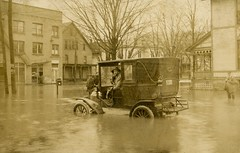 Automobile in Flooded Street, Warren, Pennsylvania, March 1913 (Alan Mays) Tags: vptp men photos brothers ephemera photographs postcards floods foundphotos rppc realphotopostcards samekey ekey greatfloodof1913 emilekey frankaekey old streets cars water weather vintage buildings march pennsylvania antique mailboxes pa warren autos 1910s automobiles licenseplates 1913 disasters warrencounty mailmen portraits occupational
