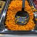 Indischer Möhren-Linsen-Salat mit Kurkuma, Bochshornklee, Fenchel, Kümmel und Curry als Salatbeilage an der digitalen Picadeli Salatbar