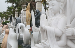 Many Carvings (peterkelly) Tags: digital canon 6d asia southeastasia vietnam gadventures indochinaencompassed highway stop sculpture statue sword praying carving prayer hands