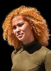 Portrait (D80_537655) (Itzick) Tags: denmark copenhagen candid color colorportrait redhead redhair youngwoman blackbackground facialexpression face streetphotography sunnyday portrait d800 itzick