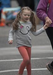Handheld (Scott 97006) Tags: girl kid blonde hands walk crossing cute street smile