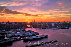 Sunset over Amsterdam (WideAngleShots) Tags: goldenhour nightphotography architecturalphotography belltower longexposure 2019 attribute amsterdam architecture bywater canals celestialbody colour concept subject structuresarchitecture sunset transportation what waterelements boat bridge canal channel church color colorful hotel night ships sun exif:aperture=ƒ64 camera:make=fujifilm camera:model=xt2 exif:isospeed=200 exif:make=fujifilm exif:lens=xf1024mmf4rois exif:focallength=24mm exif:model=xt2 500px wideangleshotscom wideangleshots