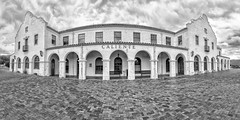 Caliente (magnetic_red) Tags: building traindepot historic pano wideangle brickwalkway columns arches stucco blackandwhite caliente lincolncounty nevada