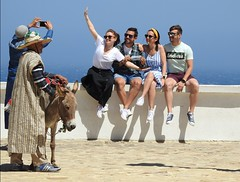 endless (derpunk) Tags: endless tourists posing morocco ridiculous silly photo photograph man donkey money white blue sky tangier tanger