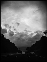 There's a killer on the road... (Creepella Gruesome) Tags: iphone6splus hipstamatic road car windshield drive motion blur sky clouds blackandwhite cinematic spooky dark mysterious phantasm