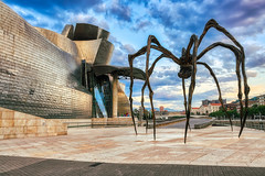 Guggenheim And The Beast (orkomedix) Tags: canon eosr rf24105f4l bilbao spain guggenheim statue maman mamá spider clouds sky museum walk view phototour