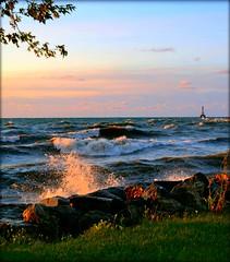 Sunrise Over Water (marymorano) Tags: water lighthouses lakemichigan sunrise waves splash nature morning sky sun