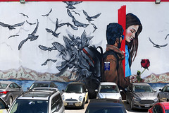 A Rose For My Love (Anthony Mark Images) Tags: art streetart wallmural painting parkinglot ottawa ontario canada man woman rose love sunglasses backpack birds flyingaway cars nikon d850 flickrclickx redrose flower