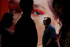 (@AmirsCamera) Tags: bangkok thailand capitol cty urban art people walking walkby streetphotography street poster woman eyes man light shadow colour color fujifilm x100s march 2019