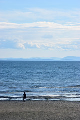 Some things are unknowable (James_D_Images) Tags: pacific ocean pacificnorthwest sea beach sand sky clouds islands layers person figure silhouette looking