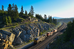 Morning Coal at Granite (SeanFKelly) Tags: bnsf crex citi citirail coal train railroad idaho northidaho panhandle mountains forest trees sunrise crosslight gleam glint sky summer rocks rocky