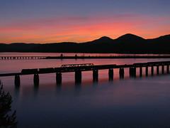 Lake Pend Oreille Sunset (SeanFKelly) Tags: bnsf sunset sandpoint idaho lakependoreille kootenai bridge railroad train silhouette sky colorful shadows reflection truss mountains northidaho panhandle spring