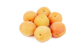 Fresh raw Apricots isolated above white background (wuestenigel) Tags: peach half natural dessert cut sweet slice background orange plant vegetarian ripe isolated yellow organic raw part whole season closeup juicy nobody healthy tasty diet group whitebackground food nutrition studio health cutout apricot freshness object vitamin fresh fruit clippingpath white