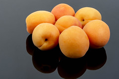 Fresh raw Apricots on the black background (wuestenigel) Tags: natural color sweet background orange plant contrast ripe isolated yellow organic vegetable market group soft closeup white nobody breakfast tasty fresh snack healthy health diet summer delicious food raw beautiful bright dessert vegetarian apricot black vitamin juicy fruit object detail