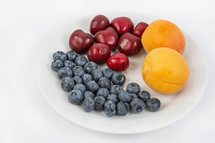 Blueberries Apricots and Cherries (wuestenigel) Tags: half color cut sweet slice background red summer vegetarian macro blueberry ripe isolated organic raw path group clipping berry closeup heap juicy healthy delicious tasty dessert green food leaf cherry nutrition ingredient diet apricot object vitamin fresh fruit stem white