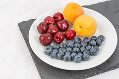 Blueberries Apricots and Cherries served on the plate (wuestenigel) Tags: half color cut sweet slice background red summer vegetarian macro blueberry ripe isolated organic raw path group clipping berry closeup heap juicy healthy delicious tasty dessert green food leaf cherry nutrition ingredient diet apricot object vitamin fresh fruit stem white