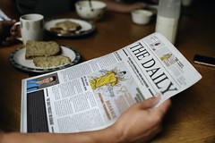 Man reading the news at the breakfast table (Sajib patwary) Tags: blank bread breakfast breakfasttable businessnews coffee copyspace daily designspace dinnertable eat eating family father food glass global happenings holding home international kitchen man meal milk mockup morning news newspaper paper plates politics psd reading served table thepaper white wooden