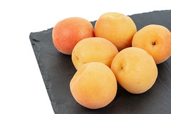 Fresh raw Apricots on the black stone tray background (wuestenigel) Tags: natural color sweet background orange plant contrast ripe isolated yellow organic vegetable market group soft closeup white nobody breakfast tasty fresh snack healthy health diet summer delicious food raw beautiful bright dessert vegetarian apricot black vitamin juicy fruit object detail