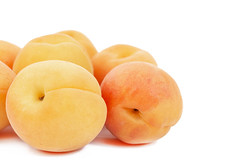 Apricots isolated above white background (wuestenigel) Tags: peach half natural dessert cut sweet slice background orange plant vegetarian ripe isolated yellow organic raw part whole season closeup juicy nobody healthy tasty diet group whitebackground food nutrition studio health cutout apricot freshness object vitamin fresh fruit clippingpath white