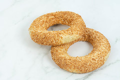 Round Pastry with sesame (wuestenigel) Tags: wholegrain crunchy crisp toasted grain eat background snack delicious golden sesameseed everythingbagel bakery meal baked wheat eating sesamebagel breakfast nutrition bagel healthy nutritious sesame tasty leaves traditional food crust studio sesameseedbagel organic brown lunch health seed fresh bread pastry round