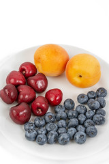 Blueberries Apricots and Cherries on the plate (wuestenigel) Tags: half color cut sweet slice background red summer vegetarian macro blueberry ripe isolated organic raw path group clipping berry closeup heap juicy healthy delicious tasty dessert green food leaf cherry nutrition ingredient diet apricot object vitamin fresh fruit stem white