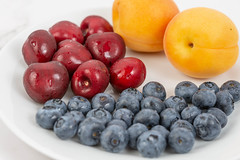 Blueberries Apricots and Cherries arranged on the plate (wuestenigel) Tags: half color cut sweet slice background red summer vegetarian macro blueberry ripe isolated organic raw path group clipping berry closeup heap juicy healthy delicious tasty dessert green food leaf cherry nutrition ingredient diet apricot object vitamin fresh fruit stem white