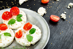 Healthy Rice Cakes. (Liva Pastacılık) Tags: rice cheese cake cakes tomato cherry healthy basil food white crackers metal plate wooden black sesame breakfast feta vegetarian chopped snack cottage summer cereal sandwich background cracker light mozzarella fresh health organic diet nutrition vegetable dinner grain salad cookie natural tasty gourmet bread appetizer uncooked