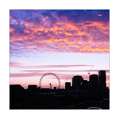 Turn the Wheel (Thomas Listl) Tags: thomaslistl color evening sunset dusk silhouette square 35mm london england uk greatbritain sky clouds saturation skyline urban cityscape landscape orange magenta ferriswheel londoneye ngc observationwheel