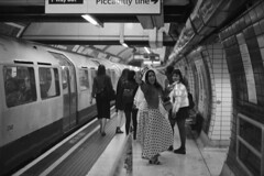 On the way to bachelorette party (Analog World Thru My Lenses) Tags: nikonfa sigma2470mmf28 ilforddelta400 june 2019 underground subway metro bw film analog 35mm streets london england bride
