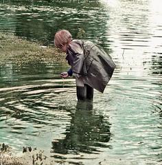 Finding muck (theirhistory) Tags: boy child children kid coat raincoat mac mackintosh wellies water rubberboots