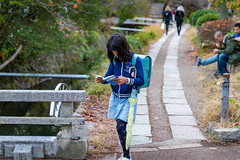 Japanese girl walking and reading book (jack-sooksan) Tags: young student study walk read reading walking book notebook concentrate japan kyoto walkway asia asian japanese girl female woman people
