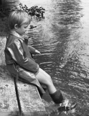 Plenty of rain (theirhistory) Tags: boy child children kid raincoat mac mackintosh wellies wellingtonboots