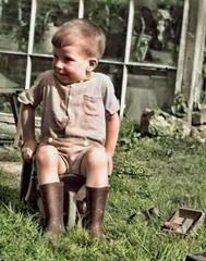Sitting still (theirhistory) Tags: boy child children kid grass shorts shirt wellies wellingtonboots