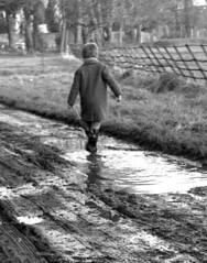 Off to school (theirhistory) Tags: boy child children kid raincoat mac mackintosh wellies wellingtonboots
