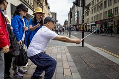 The Group Selfie (Leanne Boulton) Tags: urban street candid portrait streetphotography candidstreetphotography candidportrait streetportrait streetlife man male woman female face faces eyes expression gesture mood feeling group selfie stick selfiestick fun crouching hat tone texture detail depthoffield bokeh naturallight outdoor light shade city scene human life living humanity society culture lifestyle people canon canon5dmkiii 35mm ef2470mmf28liiusm color colour glasgow scotland uk