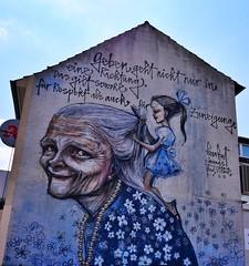 Giving doesn't just go one way... (JB Fotofan) Tags: hauswand lx100m2 lumix herakut wandbild graffiti wandgemälde mural wallpainting badvilbel
