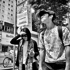 shibuya, japan (michaelalvis) Tags: asia bw blackandwhite buildings bicycle candid citylife city cellphone pedestrian fujifilm flickr fujicolor japan japon japanese japanesesigns monochrome mono nihon nippon peoplestreet portrait people peoplestreets streetphotography streetlife street signs shibuya travel tokyo urban woman walking x70 happyplanet asiafavorites