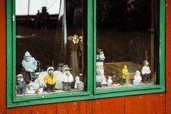 Figurines in a Shed Window (Poul-Werner) Tags: portra160 danmark denmark struer urbex venø xpro2 xf50mm contemplative dock everydayart harbour havn photowalk port urban visualpoetry centraldenmarkregion