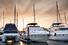 Yacht and boats at the marina in the evening (sophia.alachouzos) Tags: lake nautical outdoors pier sailboat ship vessel yachting background blue boat boats cloud day dock docked harbor luxury marina ontario port sail sailboats sea sky small storm summer sunset transportation travel water white winter yacht yachts thailand