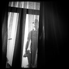 The man at the window (debeeldenplukker) Tags: window man blackandwhite monochrome zwartwit iphone iphonephotography iphoneography