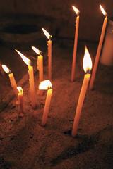 A Prayer at Nea Moni (Dr John2005) Tags: greece chios aegean johnperivolaris neamoni monastery candles chiaroscuro prayer
