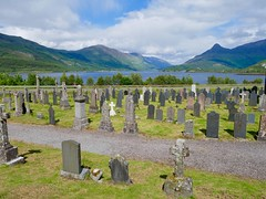 Loch Leven (lesleydugmore) Tags: gravestone green grass sky blue clouds path mountain mountainrange water scenic picturesque countryside serene lake scotland britain uk europe loch outside outdoors rural