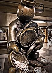 Coin Man (Alexander H.M. Cascone [insta @cascones]) Tags: nyc newyorkcity newyork ny city manhattan subway underground train atrain blueline port authority portauthority art sculpture close closeup metal coin coins money face give take mta metro