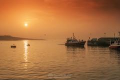 Sunset harbour (mythicalireland) Tags: sunset setting sun fishing trawler boat harbour ship water sea irish ireland clogherhead port oriel summer boats