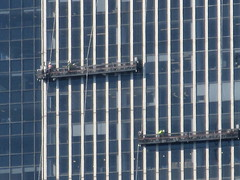 2019 Group of Window Washers on One Penn Plaza 2898 (Brechtbug) Tags: 2019 group window washers one penn plaza red number 1 light top building tower from hells kitchen clinton near times square broadway nyc 06262019 city midtown manhattan spring springtime weather dark low hanging cumulonimbus cumulus nimbus cloud hell s nemo southern view ny1 windows washer scaffold rig platform off buildings clean june